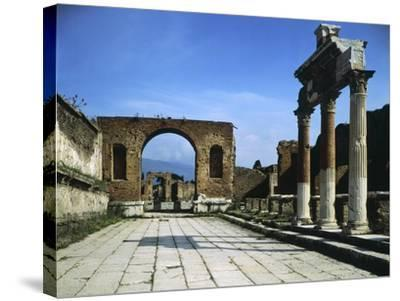Forum Showing Entrance of Macellum on Right and in Background Arch of Triumph--Stretched Canvas Print
