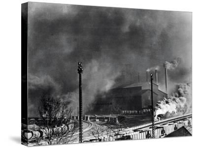 View of Steel Plant with Smoke Fumes--Stretched Canvas Print