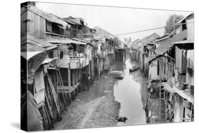Scene of Squalid Living Area in Village-Nat Gibson-Stretched Canvas Print