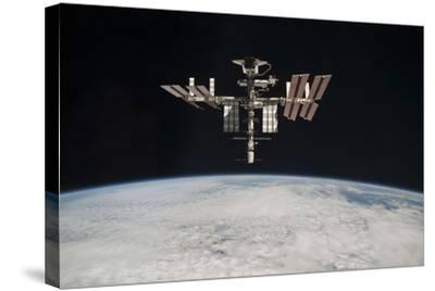 The International Space Station in Orbit Above Earth--Stretched Canvas Print