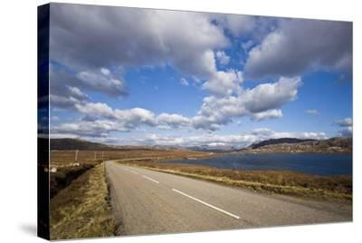 Landscape with Road, Lake and Clouds,Scotland, United Kingdom-Stefano Amantini-Stretched Canvas Print