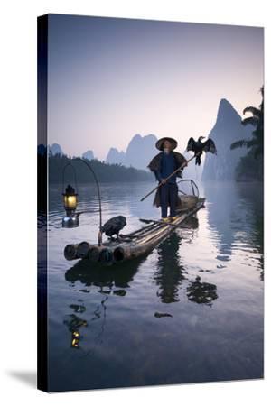 China, Guanxi, Yangshuo. Old Chinese Fisherman-Matteo Colombo-Stretched Canvas Print