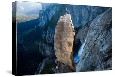 A Climber on Top of the Lost Arrow Spire in Yosemite National Park, and His Partner Far Below-Ben Horton-Stretched Canvas Print