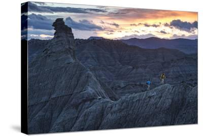 A Paleontologist and Volunteer Walk a Ridgeline in the Fossil Rich Badlands of Southern Utah-Cory Richards-Stretched Canvas Print
