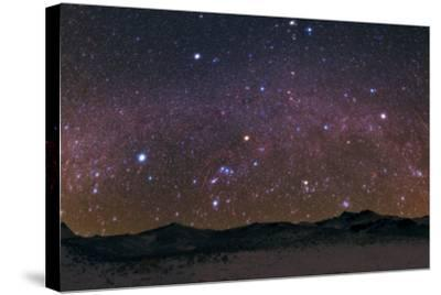 Meteors Streak the Night Sky Above the Zagros Mountains During the Geminids Meteor Shower-Babak Tafreshi-Stretched Canvas Print