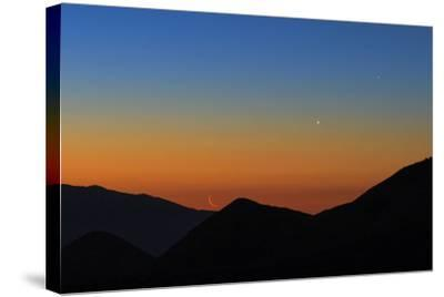 Mercury, the Bright Planet Venus, and the Crescent Moon Align over the Great Salt Desert, Iran-Babak Tafreshi-Stretched Canvas Print