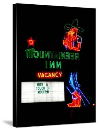 A Stereotypical Mountain Man Graces the Neon Sign of a Local Landmark-Amy and Al White and Petteway-Stretched Canvas Print