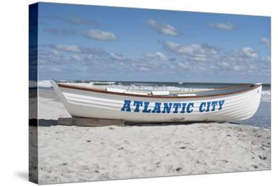 A Rowboat Sits on the Beach in Atlantic City, New Jersey-Jeff Mauritzen-Stretched Canvas Print