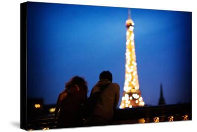 A Couple Watch the Eiffel Toer Glitter at Night in Paris, France-Chris Bickford-Stretched Canvas Print