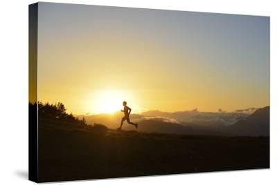 A Silhouetted Man Running Near the Verdon Gorge at Twilight-Keith Ladzinski-Stretched Canvas Print
