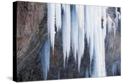 A Man Ice-Climbing an Ice Formation-Keith Ladzinski-Stretched Canvas Print