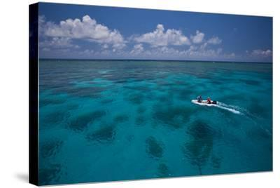 A Dinghy at the Great Barrier Reef-Michael Melford-Stretched Canvas Print