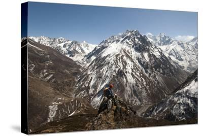 A Trekker Looks Out at the View of Ganesh Himal Mountains in Nepal-Alex Treadway-Stretched Canvas Print