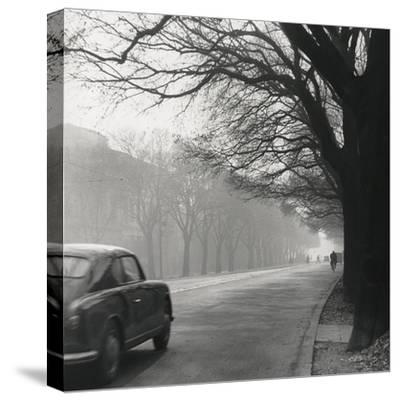 Cars on the Avenues with Fog-Renzo Ferrini-Stretched Canvas Print