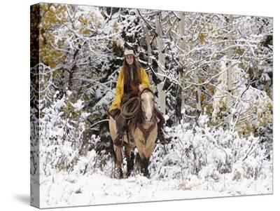 Cowgirl Riding in Autumn Aspens with a Fresh Snowfall-Terry Eggers-Stretched Canvas Print