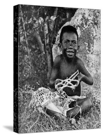 Kiwai Child, Living at the Entrance to the Fly River, New Guinea, 1922-WN Beaver-Stretched Canvas Print