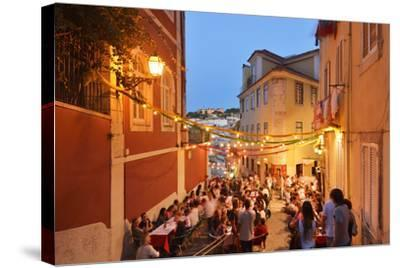 A Restaurant in the Calcada Do Duque, with a View to Sao Jorge Castle at Twilight. Lisbon, Portugal-Mauricio Abreu-Stretched Canvas Print