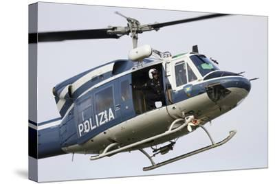 An Agusta Bell 212 of Italy's State Police in Flight over Italy-Stocktrek Images-Stretched Canvas Print
