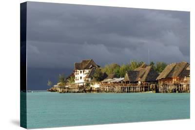 Tanzania, Zanzibar, Nungwi, Tourist Resort on Stilts-Anthony Asael-Stretched Canvas Print