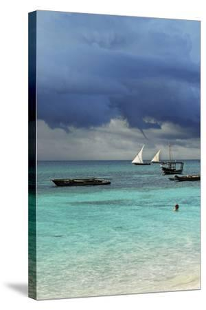 Tanzania, Zanzibar, Nungwi, Traditional Sailing Boat with Storm-Anthony Asael-Stretched Canvas Print