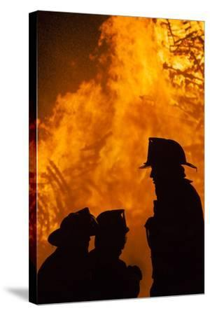Massachusetts, Cape Ann, Fourth of July Bonfire, Silhouette of Firemen-Walter Bibikow-Stretched Canvas Print