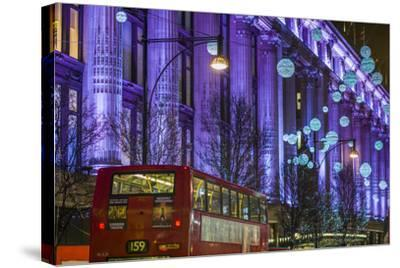 England, London, Soho, Oxford Street, Christmas Decorations and Bus-Walter Bibikow-Stretched Canvas Print