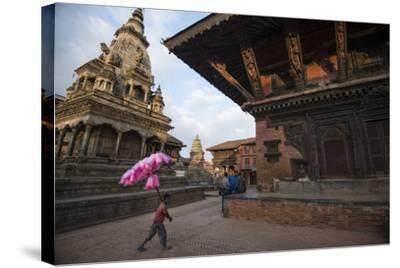 A Young Cotton Candy Seller Walking Through Durbar Square-Michael Melford-Stretched Canvas Print
