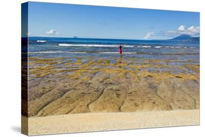 A Woman in a Pink Shirt Takes in a View of the Pacific Ocean from One the Batanes Islands-Mike Theiss-Stretched Canvas Print