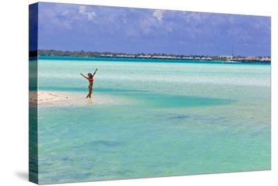 A Woman in a Bikini Posing in the Turquoise Waters at Bora Bora-Mike Theiss-Stretched Canvas Print