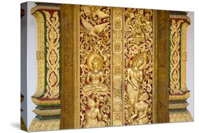Gilded Wall Carvings at Wat Xieng Thong Monastery-Michael Melford-Stretched Canvas Print