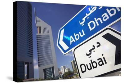 Direction Signs on Sheikh Zayed Road in Dubai-Jon Hicks-Stretched Canvas Print