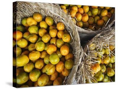 Oranges in a Myanmar Market-Jon Hicks-Stretched Canvas Print