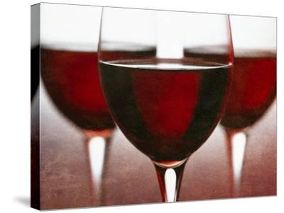 Three Stemmed Glasses of Red Wine-Steve Lupton-Stretched Canvas Print