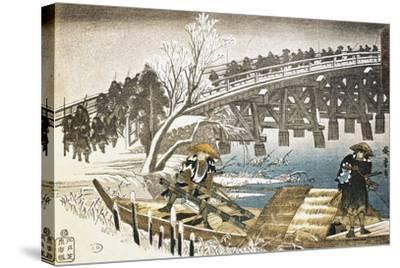 Men in Boat on River with Bridge and Snowy Landscape in Background--Stretched Canvas Print