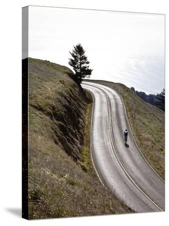 A Bicyclist Riding in Mount Tamalpais State Park, with the Pacific Ocean in the Distance-Keith Barraclough-Stretched Canvas Print