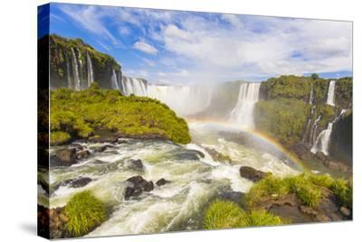 A Rainbow at Iguazu Waterfalls on the Border of Argentina and Brazil in South America-Mike Theiss-Stretched Canvas Print