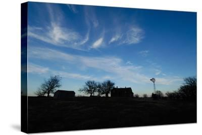 Silhouette of Barns and a Windmill Against Blue Sky-Michael Forsberg-Stretched Canvas Print