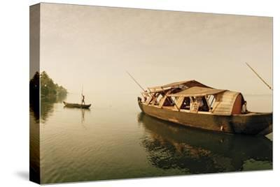 A Rice Boat Converted to a Houseboat Floats on Backwaters of Kerala-Macduff Everton-Stretched Canvas Print