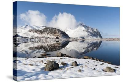 Mountains Reflect into the Calm Water of a Lake-Sergio Pitamitz-Stretched Canvas Print