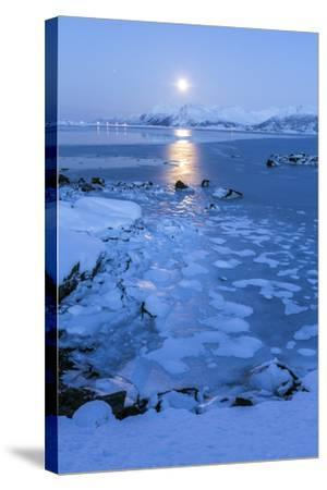 Reflections of Full Moon in the Frozen Sea, Lyngedal, Lofoten Islands, Arctic, Norway, Scandinavia-Roberto Moiola-Stretched Canvas Print