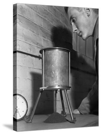 A Lab Technician Undertaking a Coal Flow Test, Mapperley Colliery, Derbyshire, 1962-Michael Walters-Stretched Canvas Print