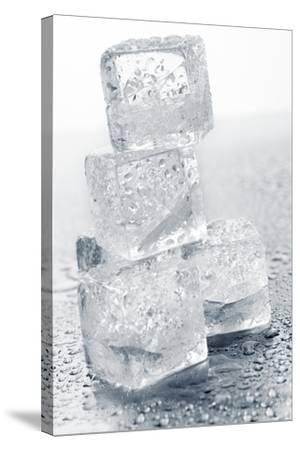 Ice Cubes in a Pile-Kr?ger and Gross-Stretched Canvas Print