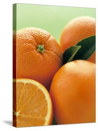 Oranges with Leaves Close Up-Leigh Beisch-Stretched Canvas Print