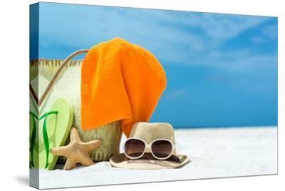 Summer Beach Bag with Coral,Towel and Flip Flops on Sandy Beach-oleggawriloff-Stretched Canvas Print