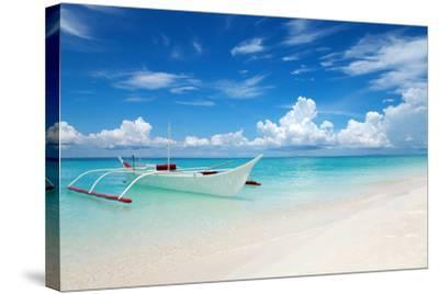 White Boat on A Tropical Beach-and.one-Stretched Canvas Print