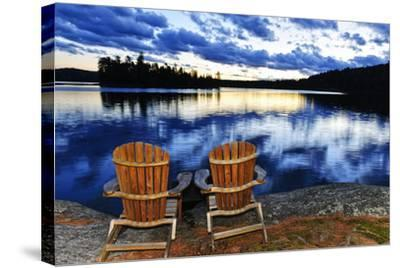 Landscape with Adirondack Chairs on Shore of Relaxing Lake at Sunset in Algonquin Park, Canada-elenathewise-Stretched Canvas Print