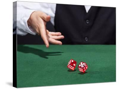 Croupier Throwing A Pair of Dice-AndreyPopov-Stretched Canvas Print
