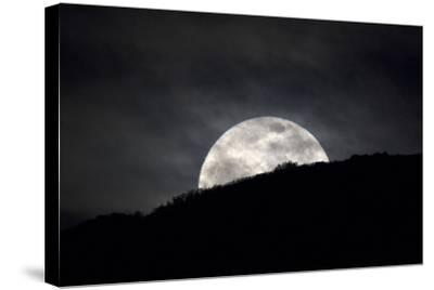 The Full Moon Rising over the Horizon-Robbie George-Stretched Canvas Print