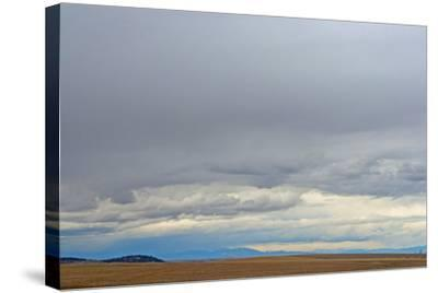 A Spring Storm Hovers over Harvested Wheat Fields in the Gallatin Valley, Near Bozeman, Montana-Gordon Wiltsie-Stretched Canvas Print