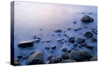 Surf Washes Through Rocks on the Shore-Paul Colangelo-Stretched Canvas Print